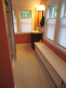 turning that corner to the left, the shower's ahead and left, the window seat opens in front for storage